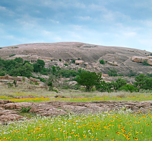 Travelers love snapping pictures of Enchanted Rock's pink granite dome. Photo courtesy of Daryl Whitworth.