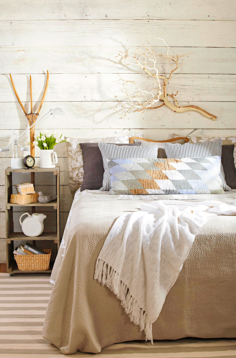 Wood-paneled, farm-style bedroom