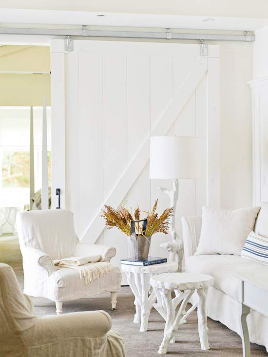 White room with barn doors