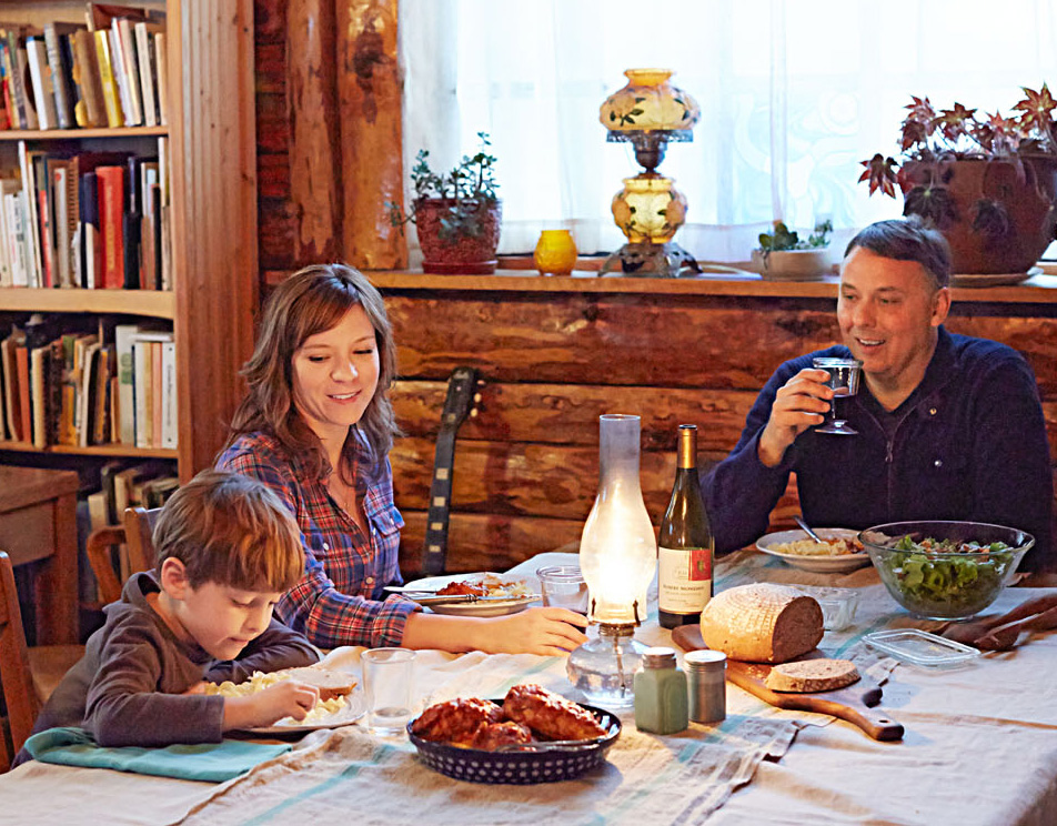 Dinner with a cookbook author looks comfortingly like mealtime in any family's home; Hank takes his noodles plain before racing back to his room to play.