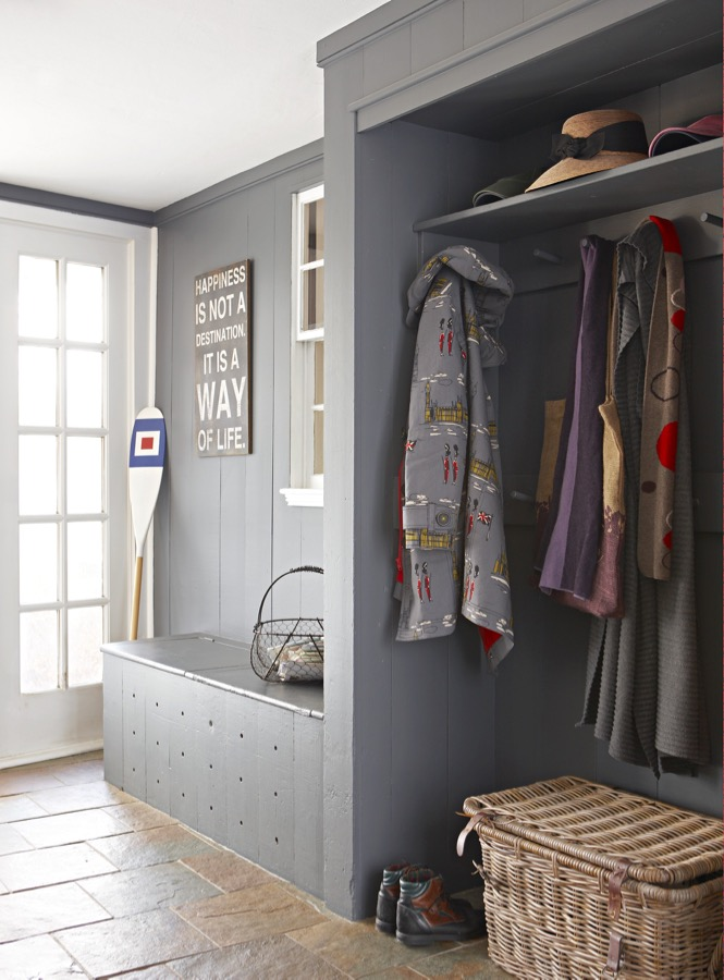 Gray built-in storage adds a clean modern look to this mudroom.