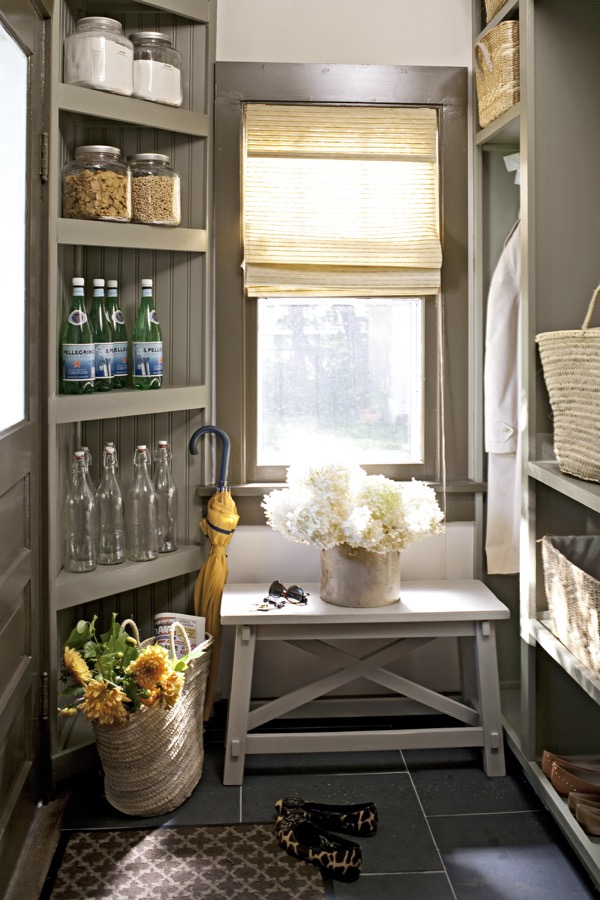 A mudroom with pantry storage.