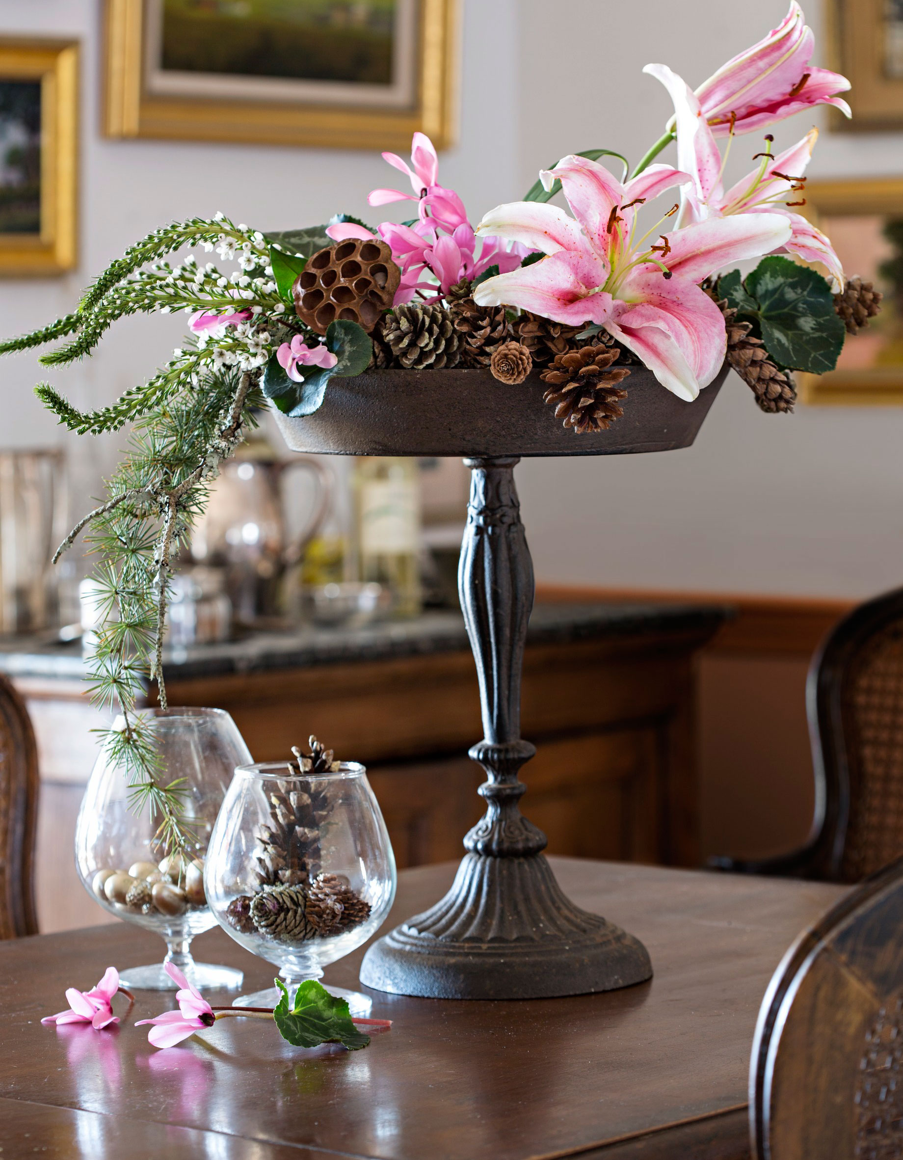 Lilies and cones in footed dish