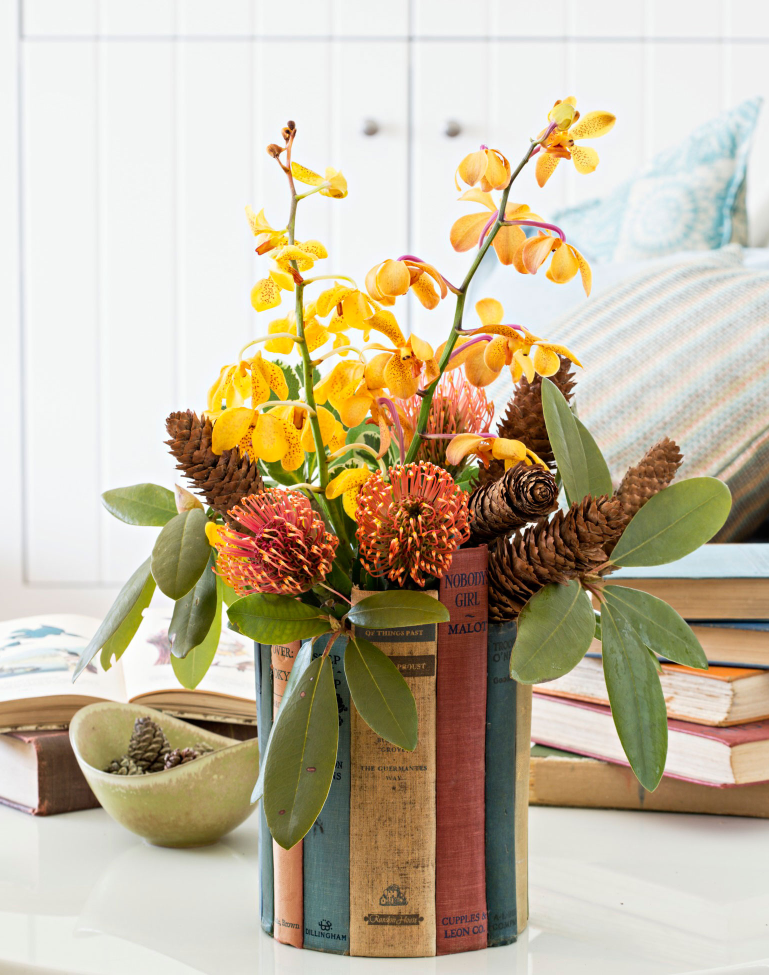 Orchids in a book vase