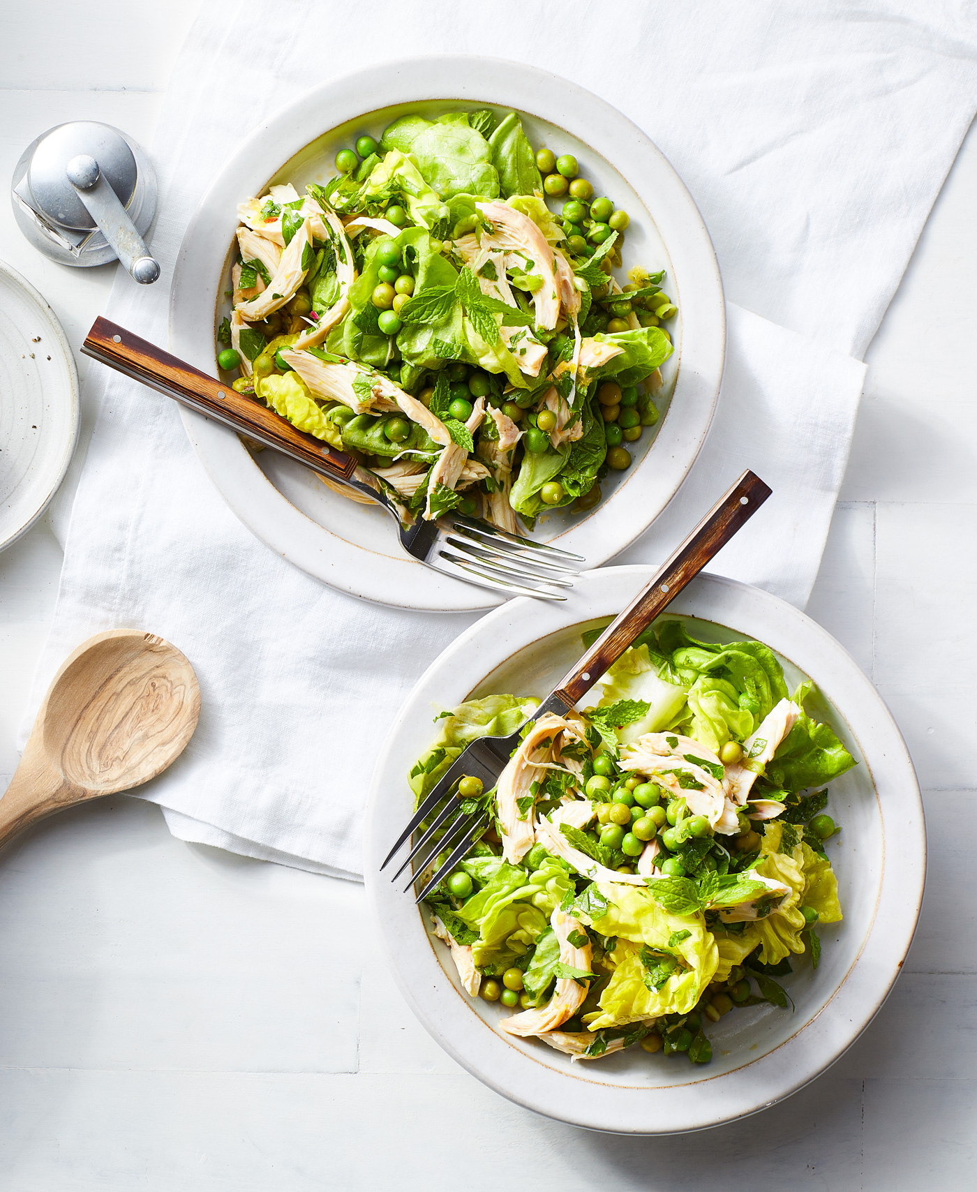 two plates of Green Salad with Chicken and Marinated Peas