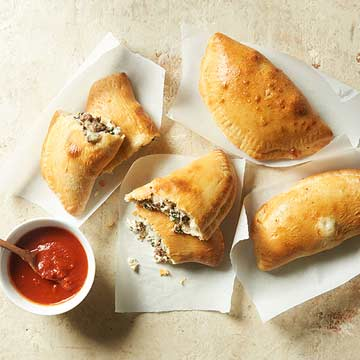 Cheesy Spinach and Beef Calzones