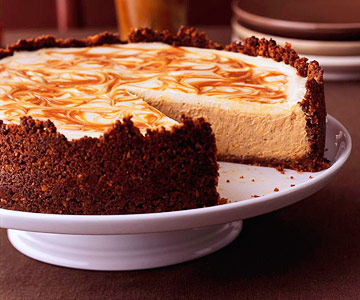 Pumpkin Cheesecake With A Caramel Swirl