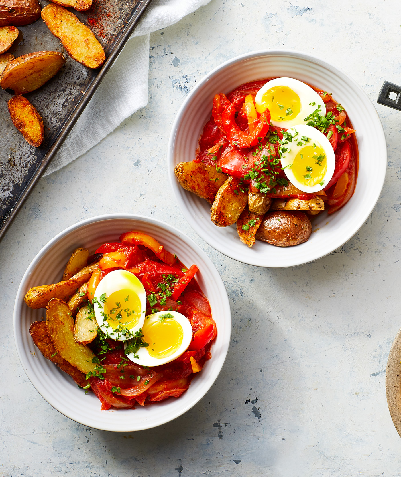two bowls of Peperonata with Potatoes and Egg on counter