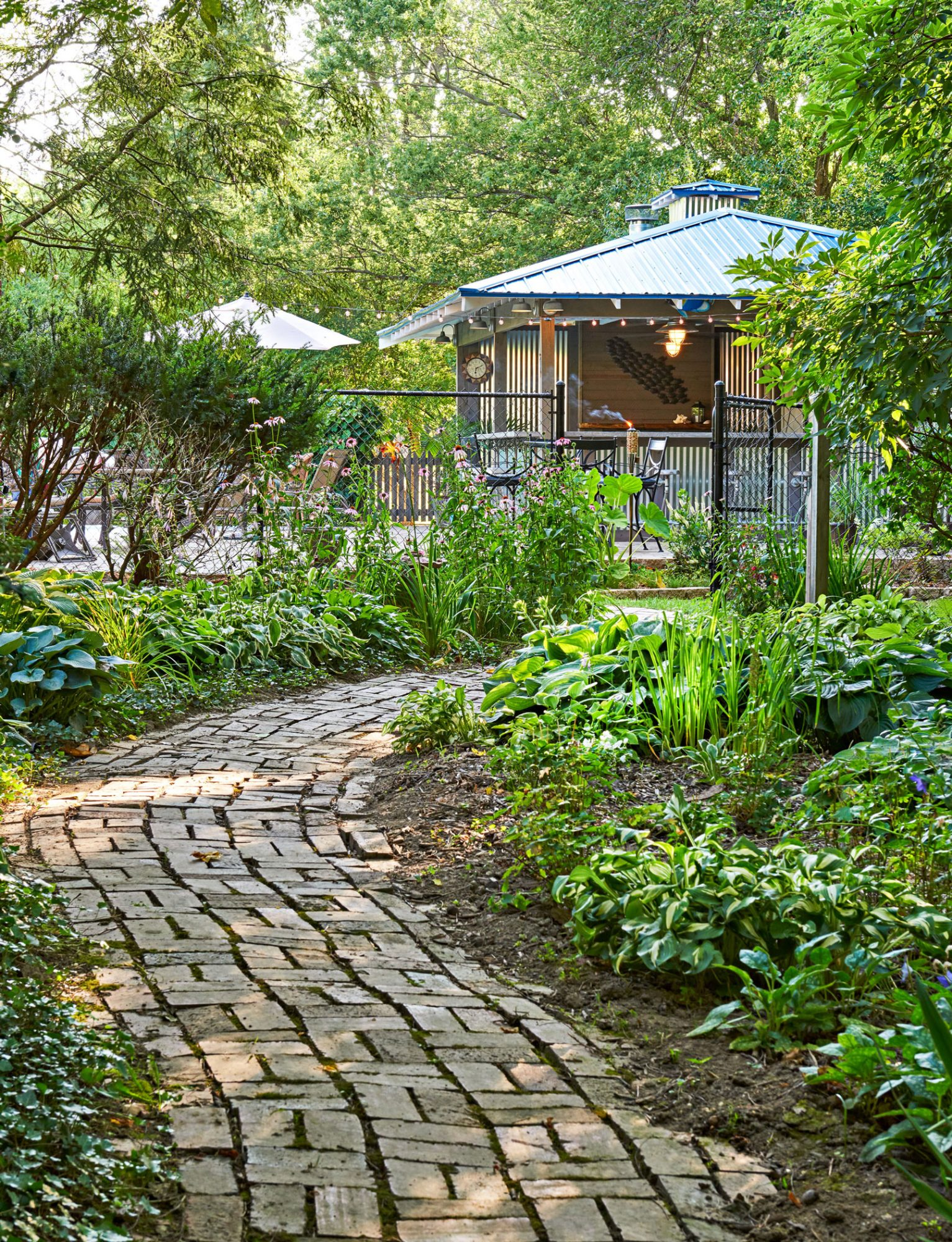 Hosta-lined path to pool house