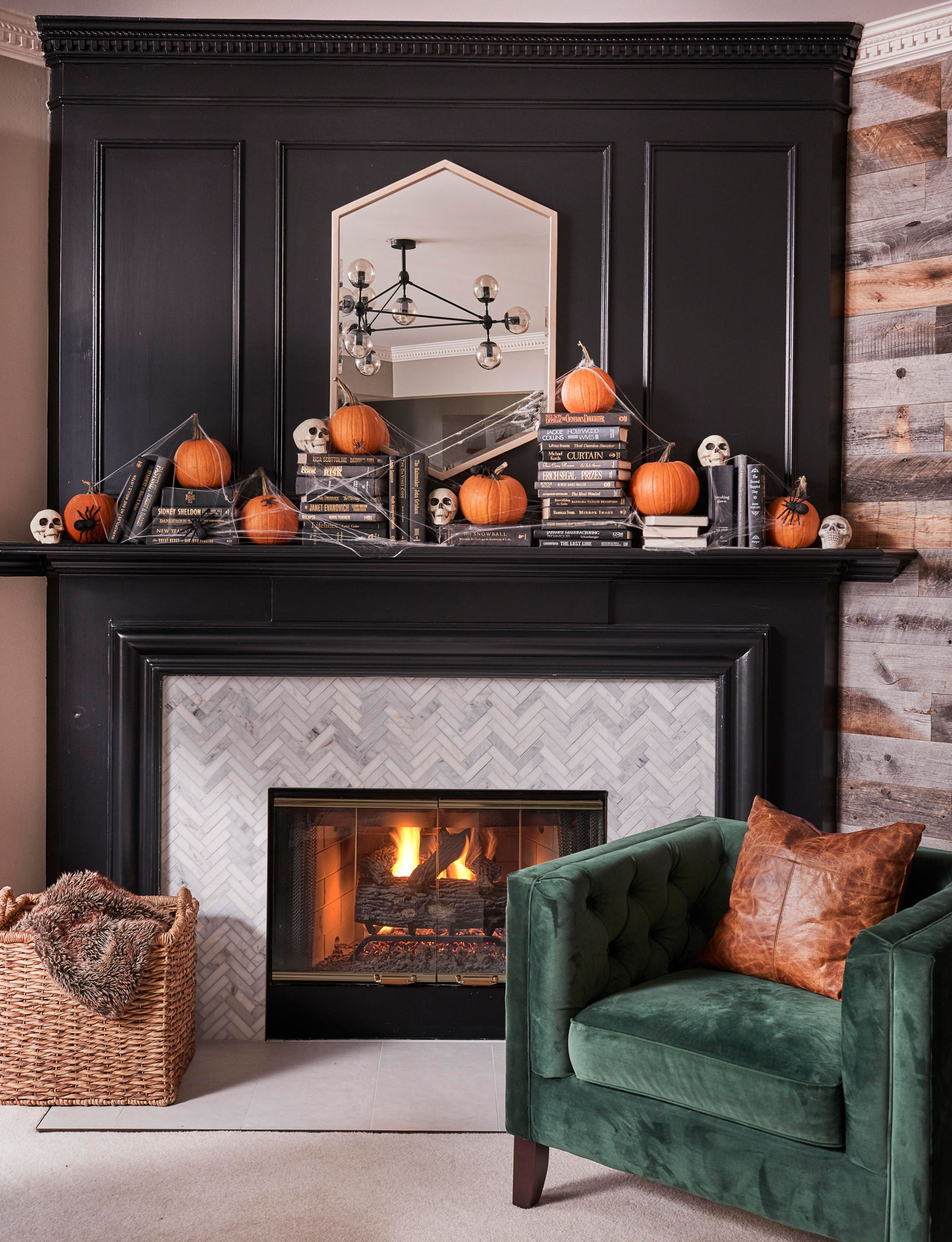 Spooky mantel with pumpkins