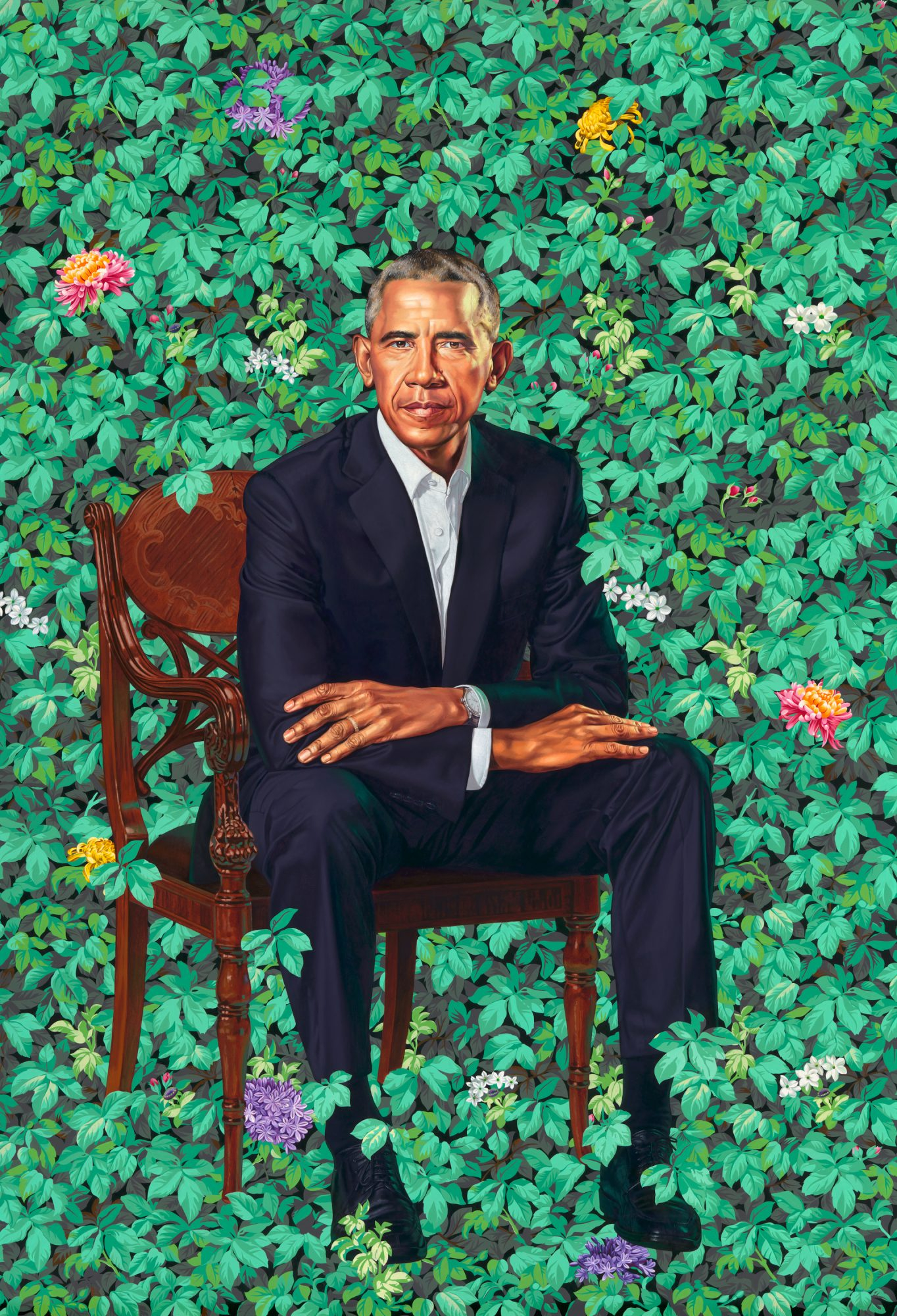 Portrait of President Barack Obama sitting in front of foliage