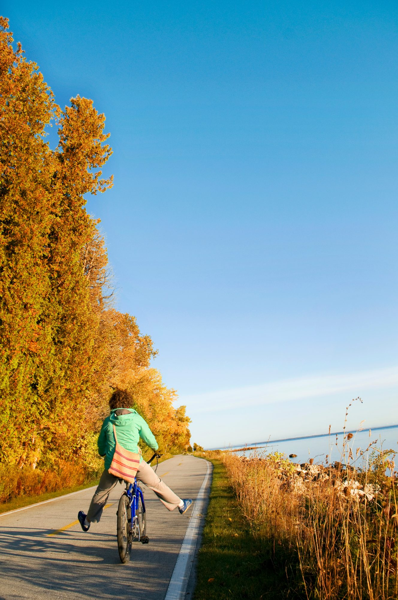 Cycling is the best way to explore auto-free Mackinac Island. Come September, riders can pedal downtown without brushing another tourist's tires and admire the softball-size dahlias and drifts of black-eyed Susans at the Grand Hotel. An 8-mile paved trail circles Mackinac. Inland, 140 miles of carriage roads, bike trails and footpaths knit through a hilly and wooded landscape, past limestone outcrops. Scott's Road and the Tranquil Bluff Trail trace the eastern shore, where red, brown and golden leaves drift down from a canopy of red oak, beech and maple.