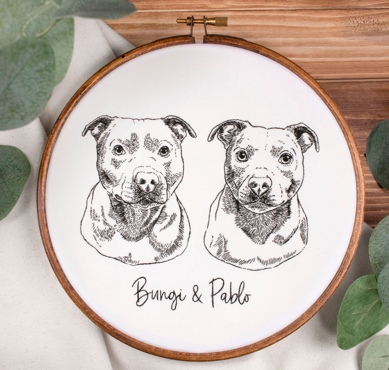 black embroidery project of two dogs