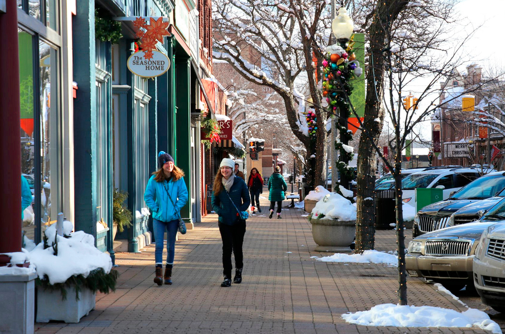 people walking through festively decorated downtown holland