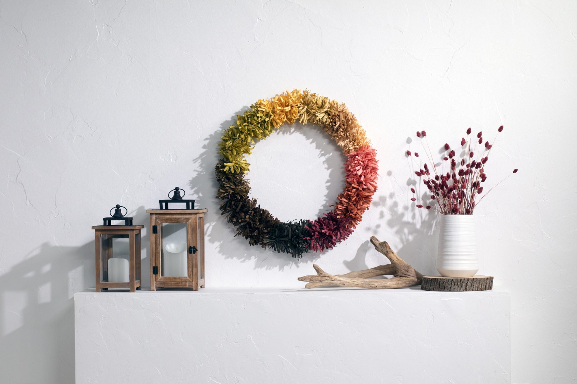 Colorful paper raffia wreath form for fall