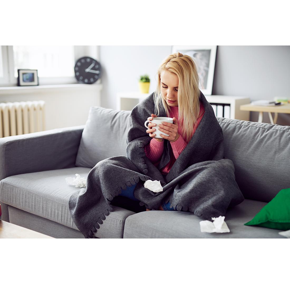 Sick woman drinking tea