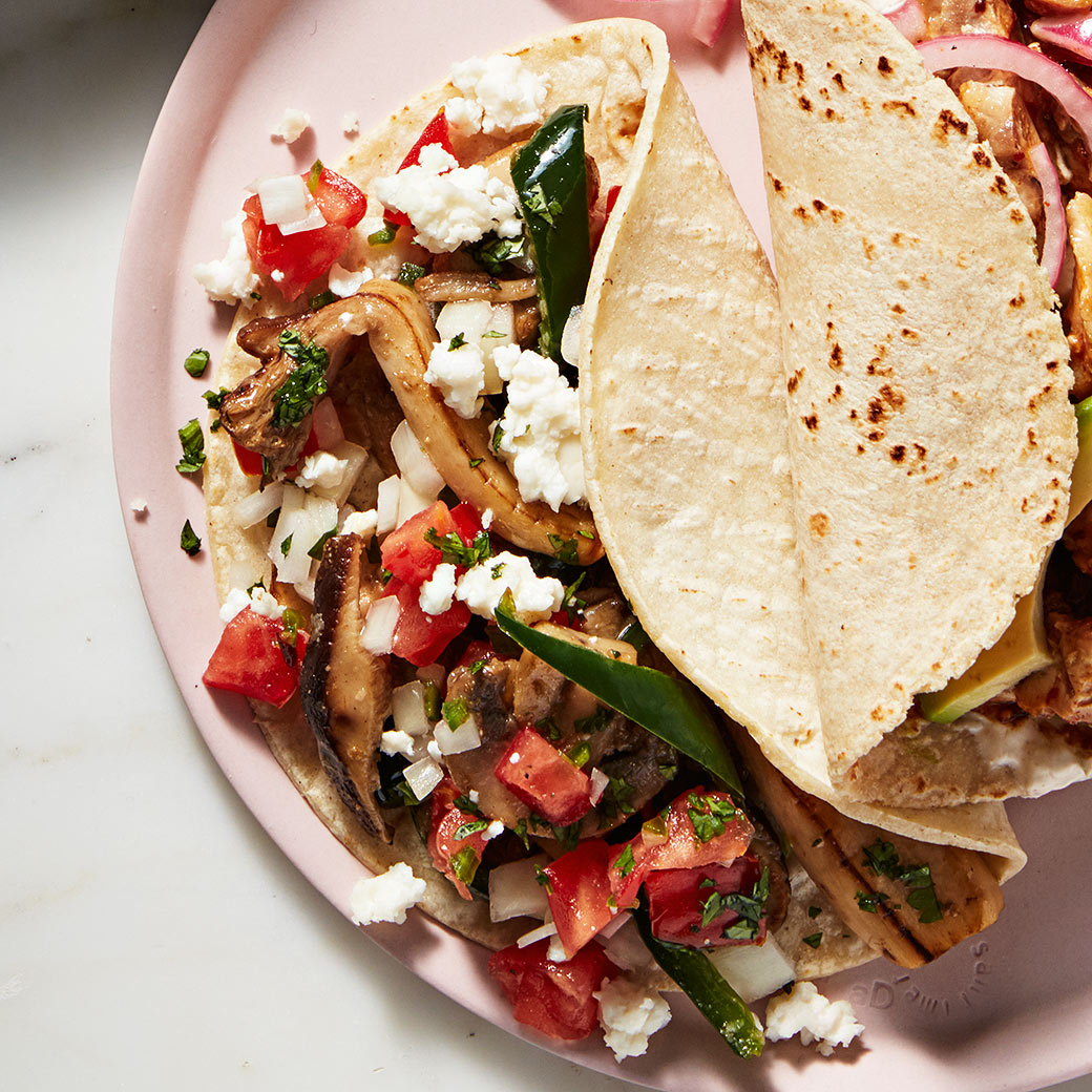 mushroom and poblano taco with pico de gallo on plate