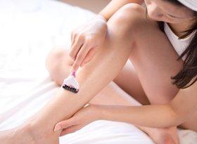 Girl shaving legs