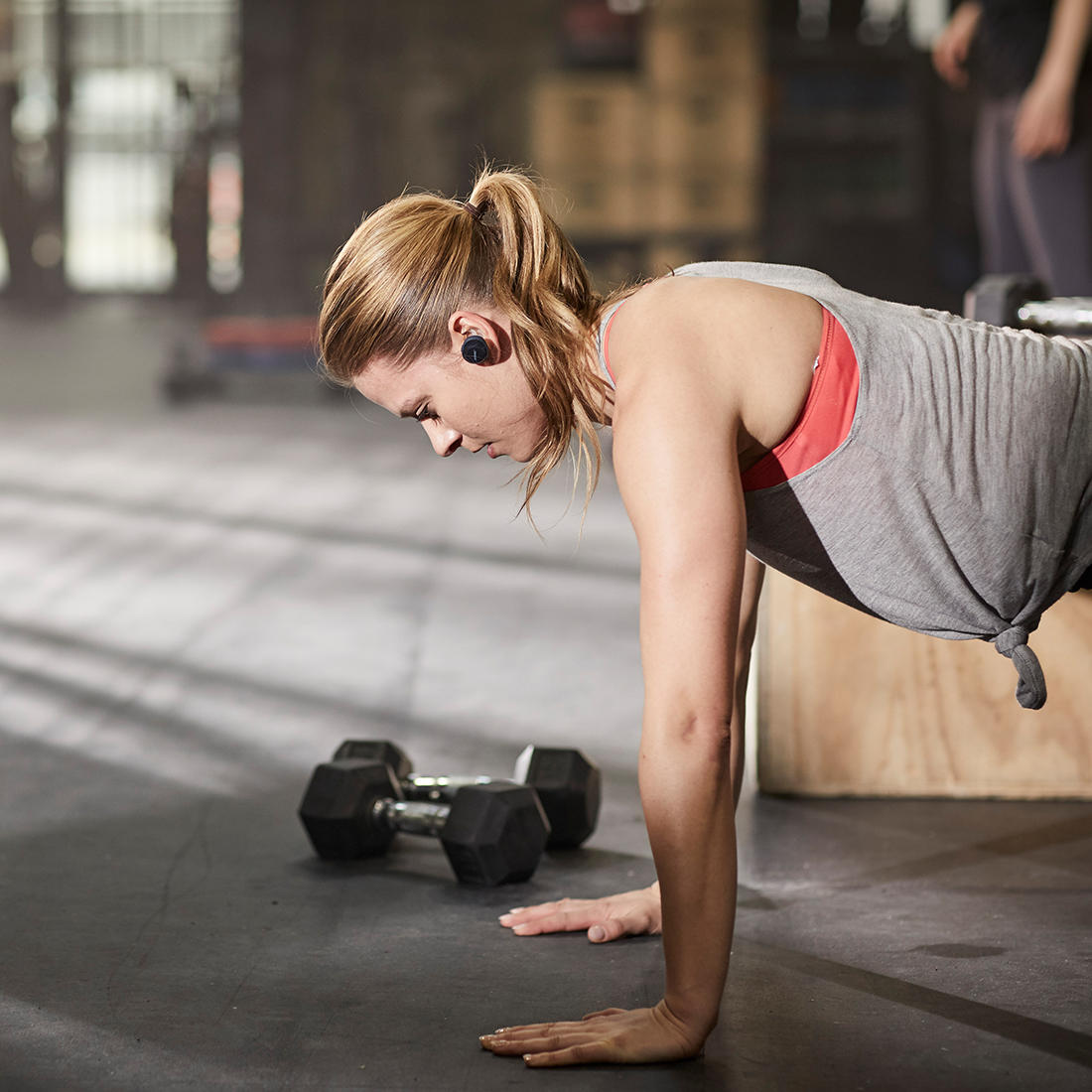 Woman working out wearing Bose SoundSport Free