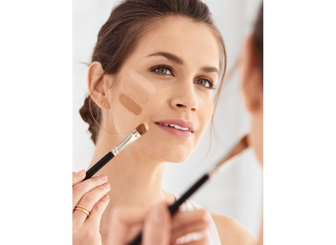 Woman testing foundation shades