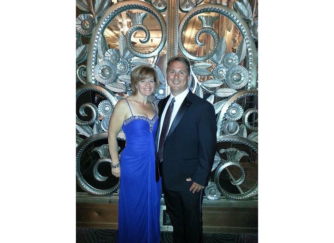 Wendy Rowland and Husband Blue Dress