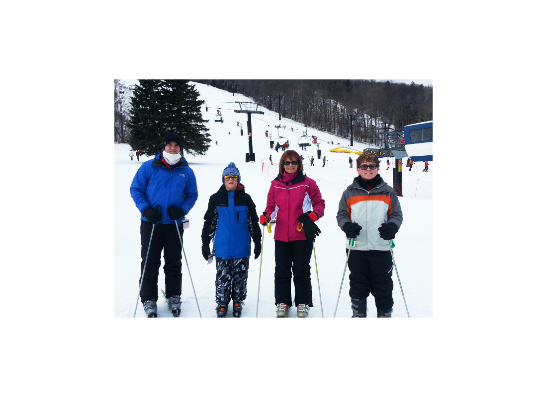 Wendy Rowland and family skiing