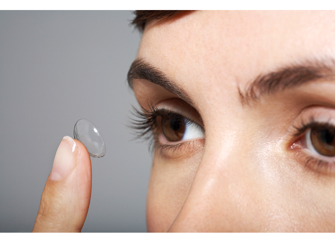 woman putting in contact lens