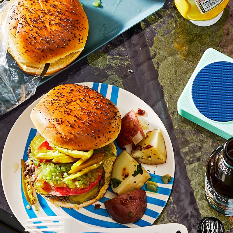 chicago-style burger and potatoes on plate