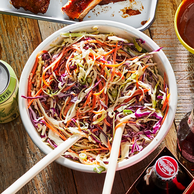 peppery coleslaw with servers