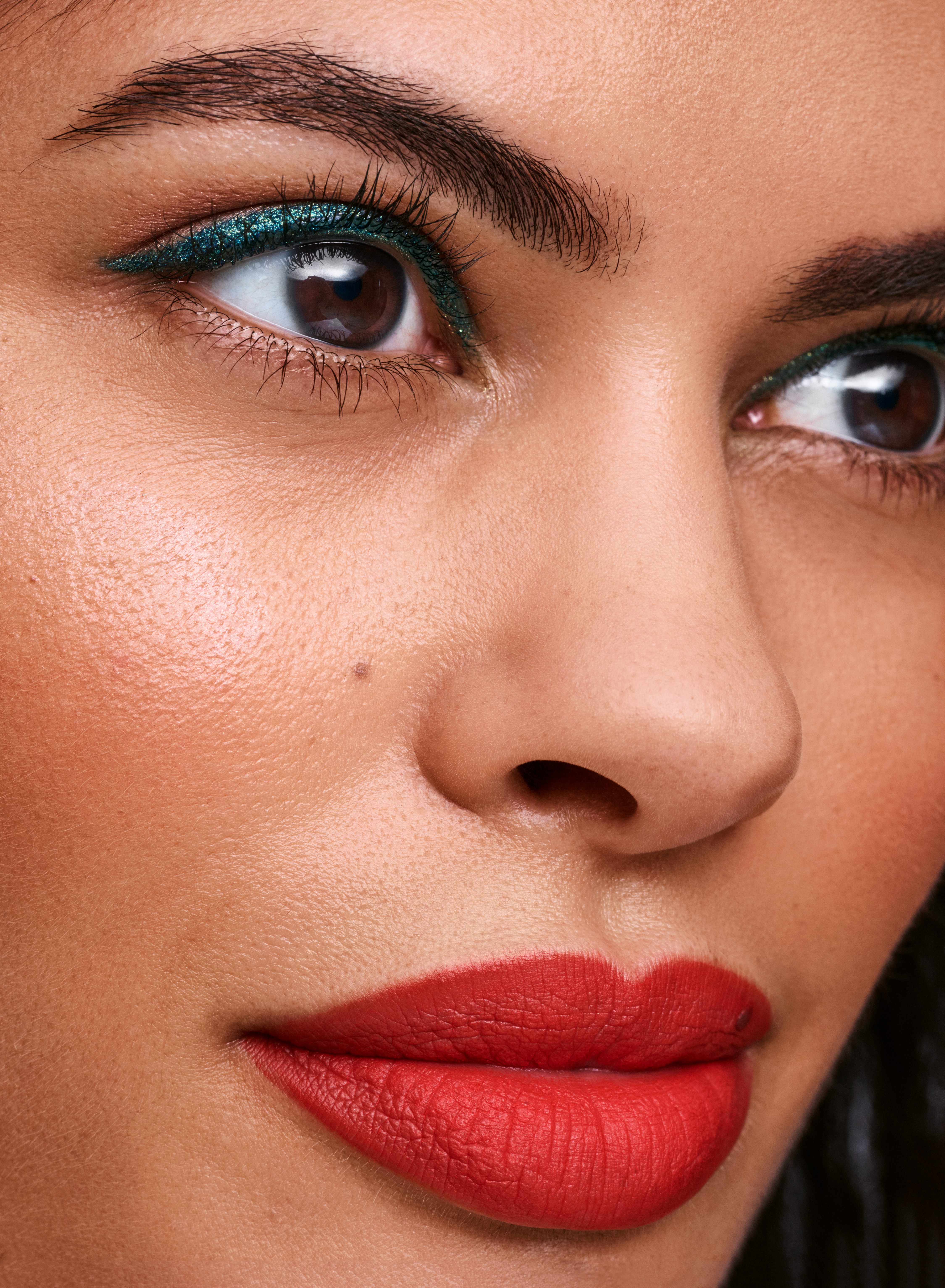 matte lipstick and teal eyeliner