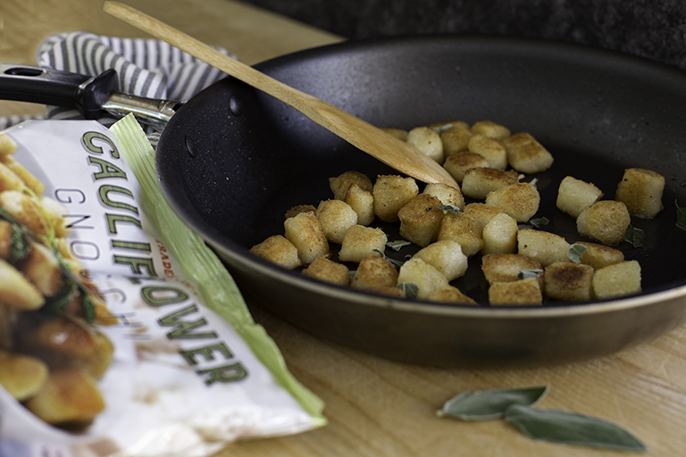 "Made with 75 percent cauliflower, plus a bit of gluten-free cassava flour, olive oil, and salt, these lower-carb gnocchi are a healthy-minded mangia kids and adults alike will adore. Use this Trader Joe's food to…lighten up a hearty Italian entreeDig in to a big bowl of these prosciutto-topped ""pasta"" pillows for about 425 calories. With plenty of fresh veggies via the peas and cauliflower, each serving offers a lot of satisfaction in a fairly fit package.Get the recipe: Gnocchi, Peas and Prosciutto"