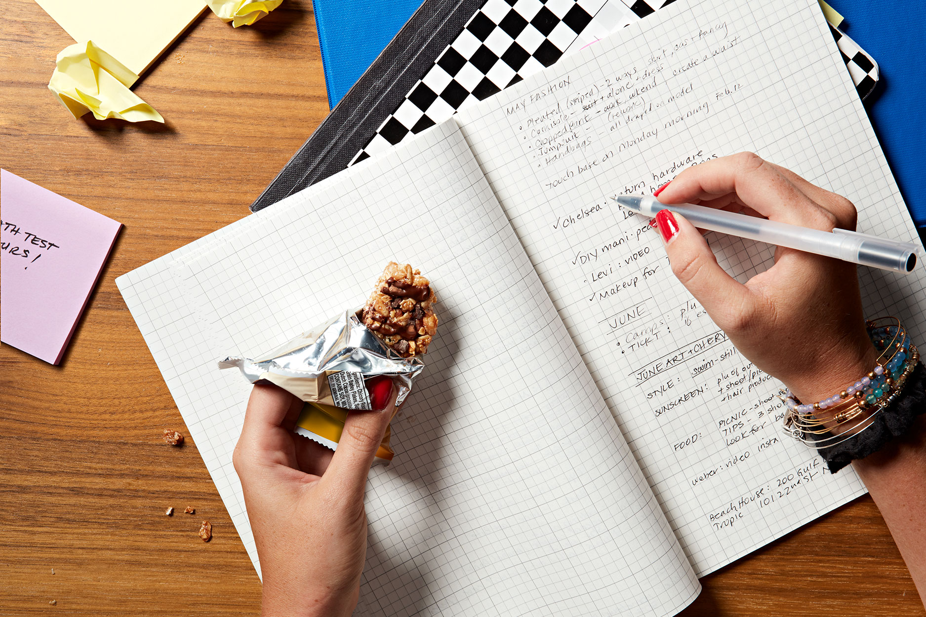 granola bar and writing in notebook
