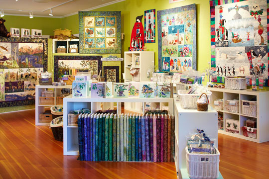 McKenna's store has a large display of her quilts on the