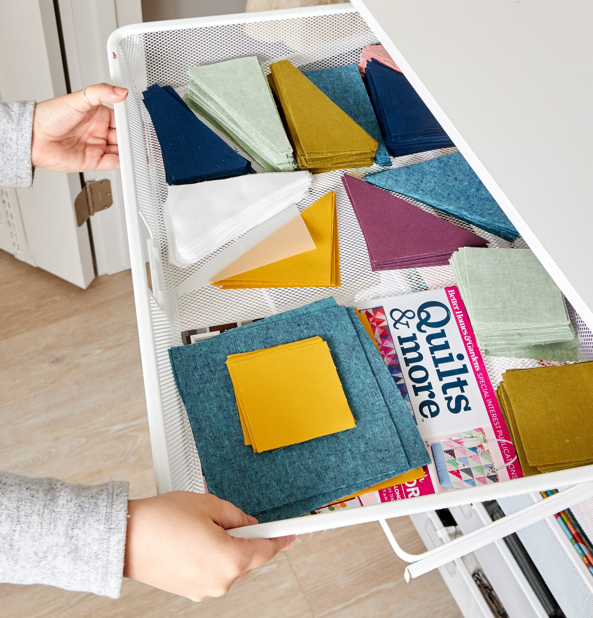 Use trays or pullout drawers to store in-progress projects. They allow you to keep all pieces and tools for a project organized and available and are easy to move from storage to work space.