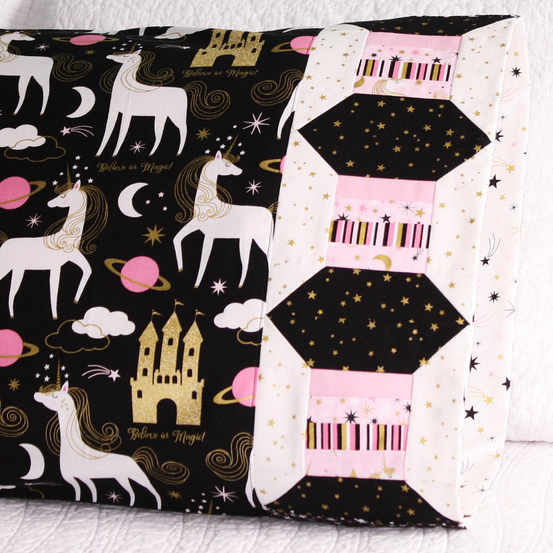 Thread spool pillowcase in northcott fabric.