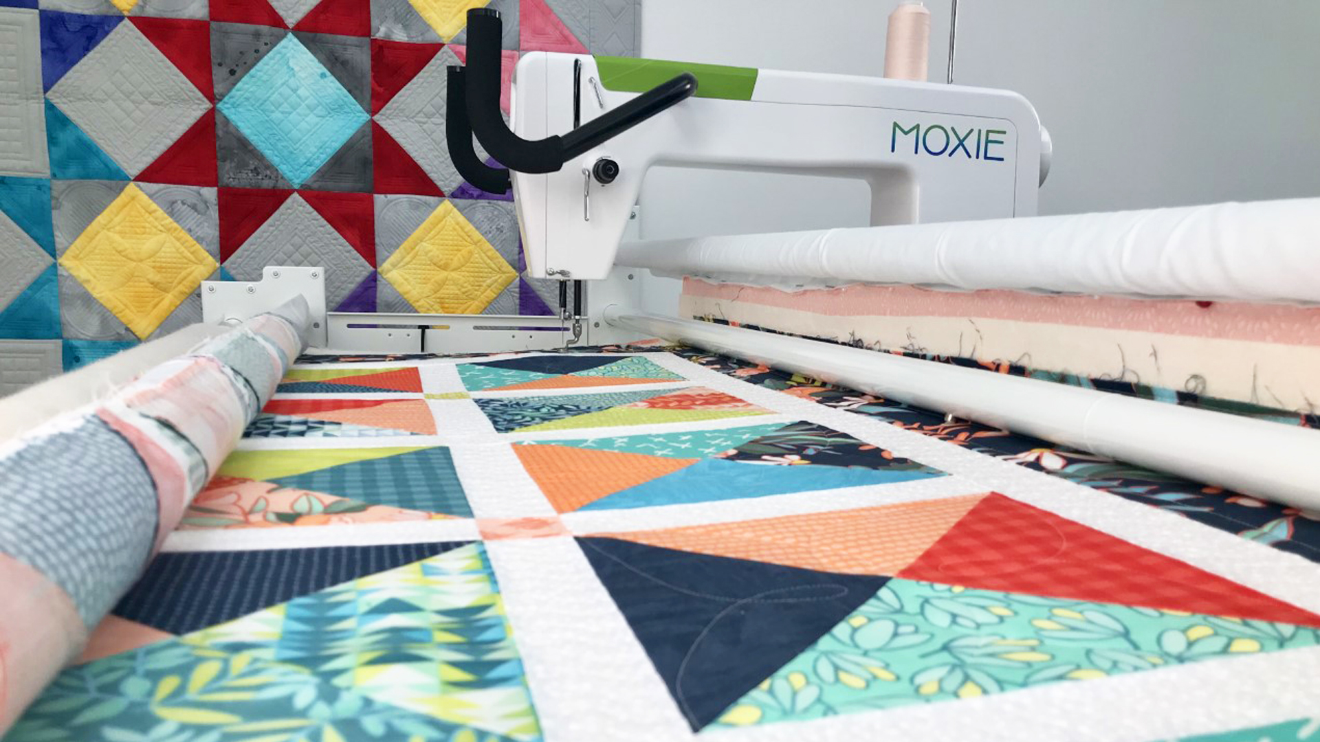 Quilt with Handi Quilter Moxie in the background