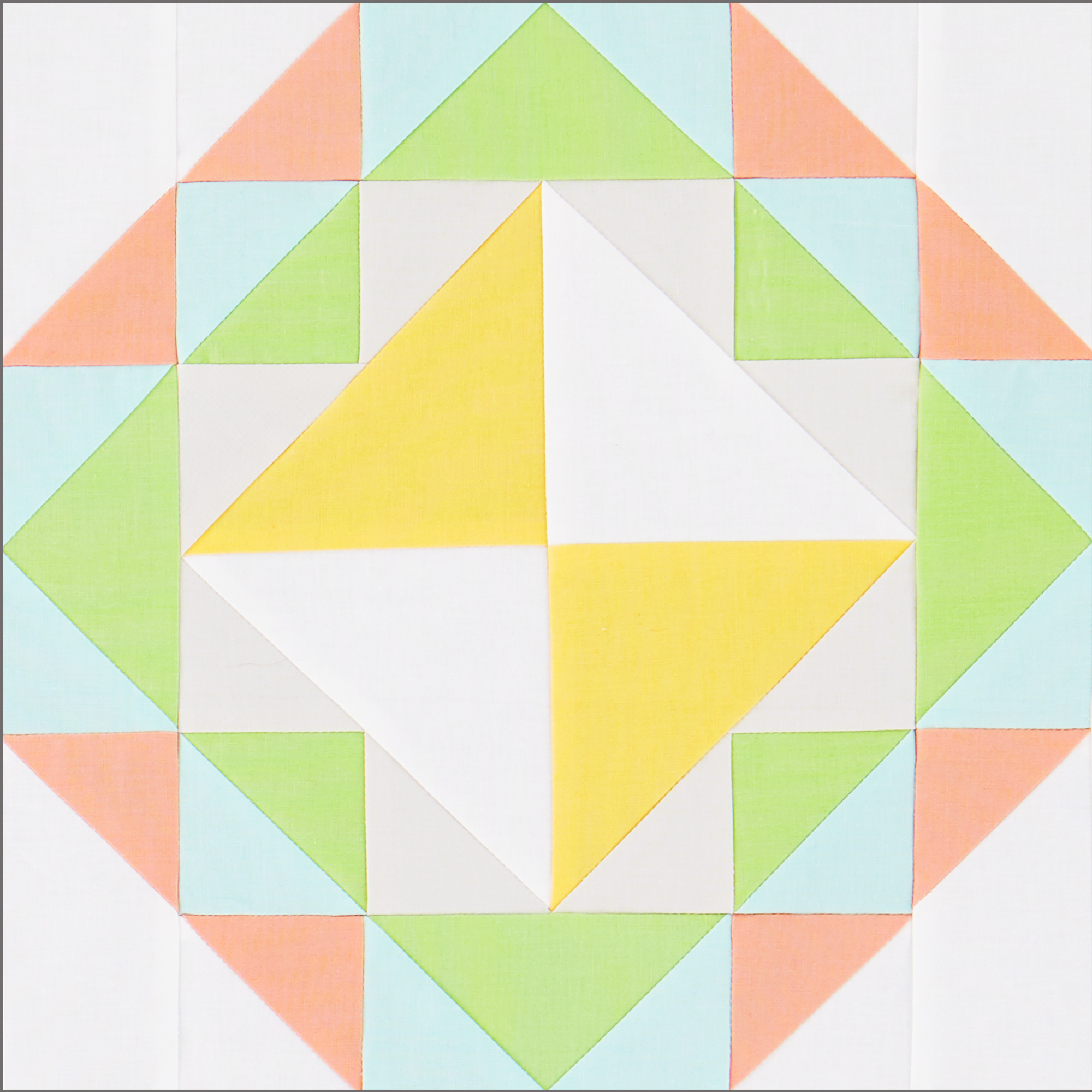 Block with Hourglass, Flying Geese and Triangle Squares in Pink, Blue, Green, and Yellow Solids.