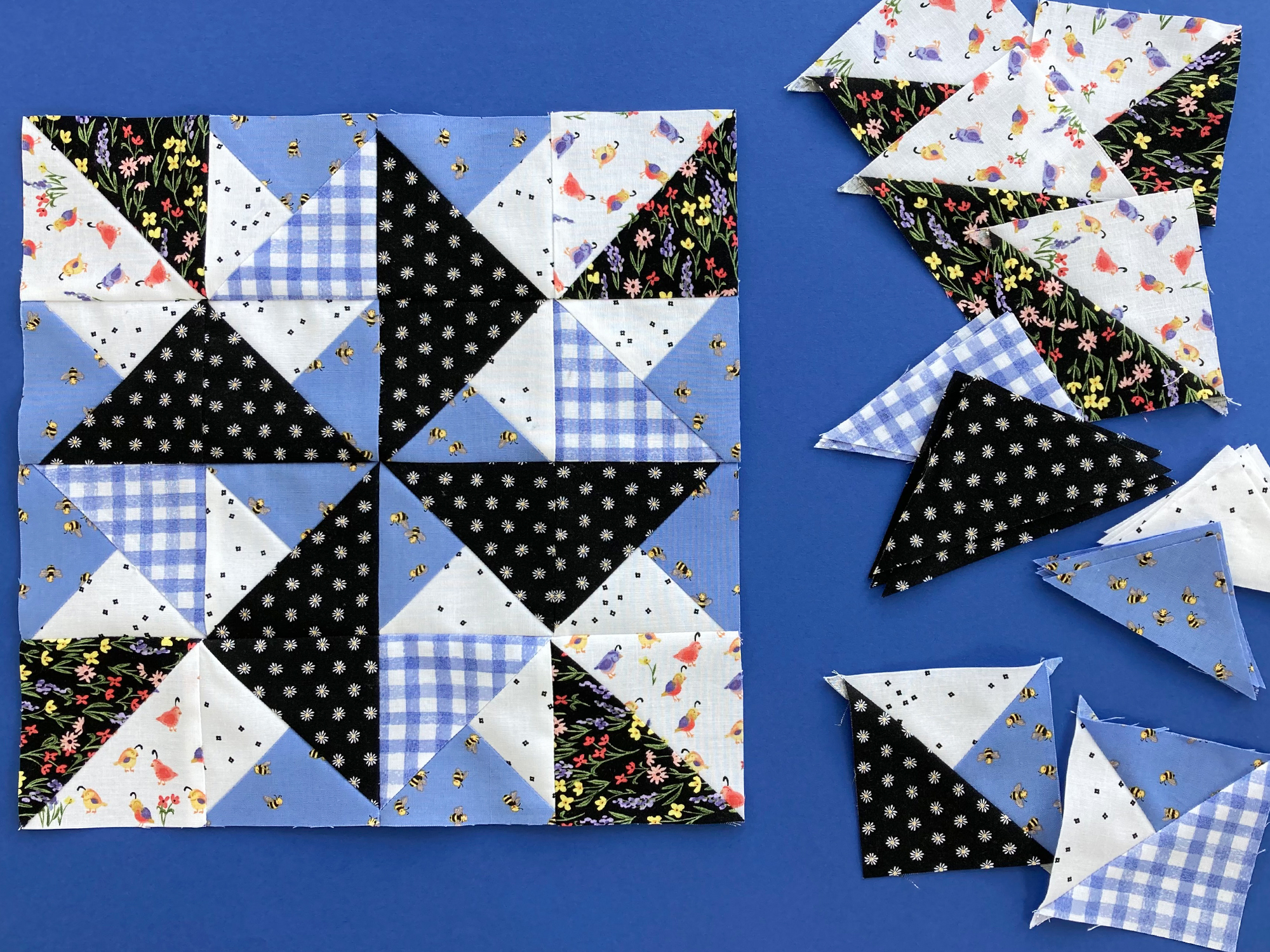 Block 5 made with blue gingham and floral fabric from Riley Blake Designs