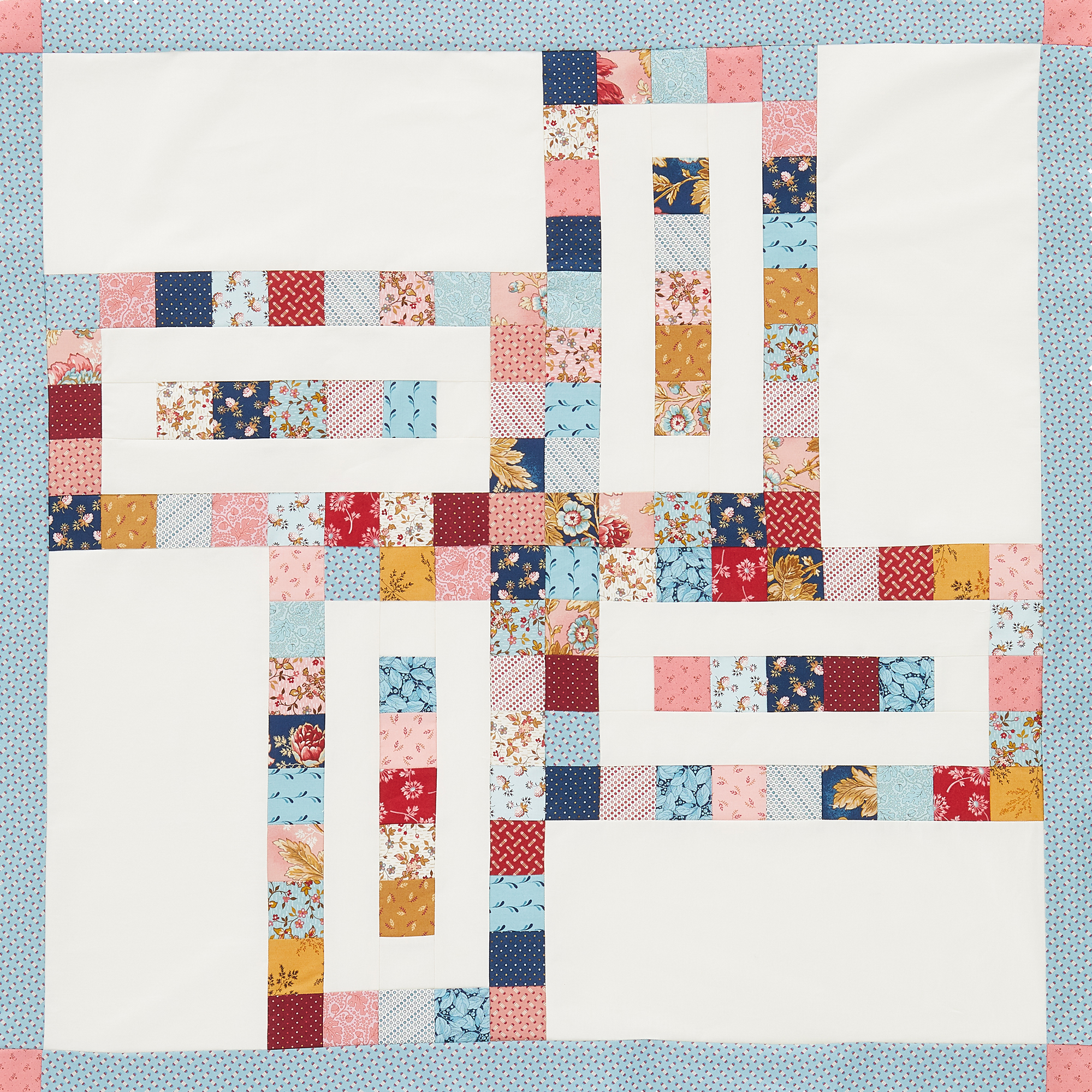 Abstract Pinwheel Baby Quilt