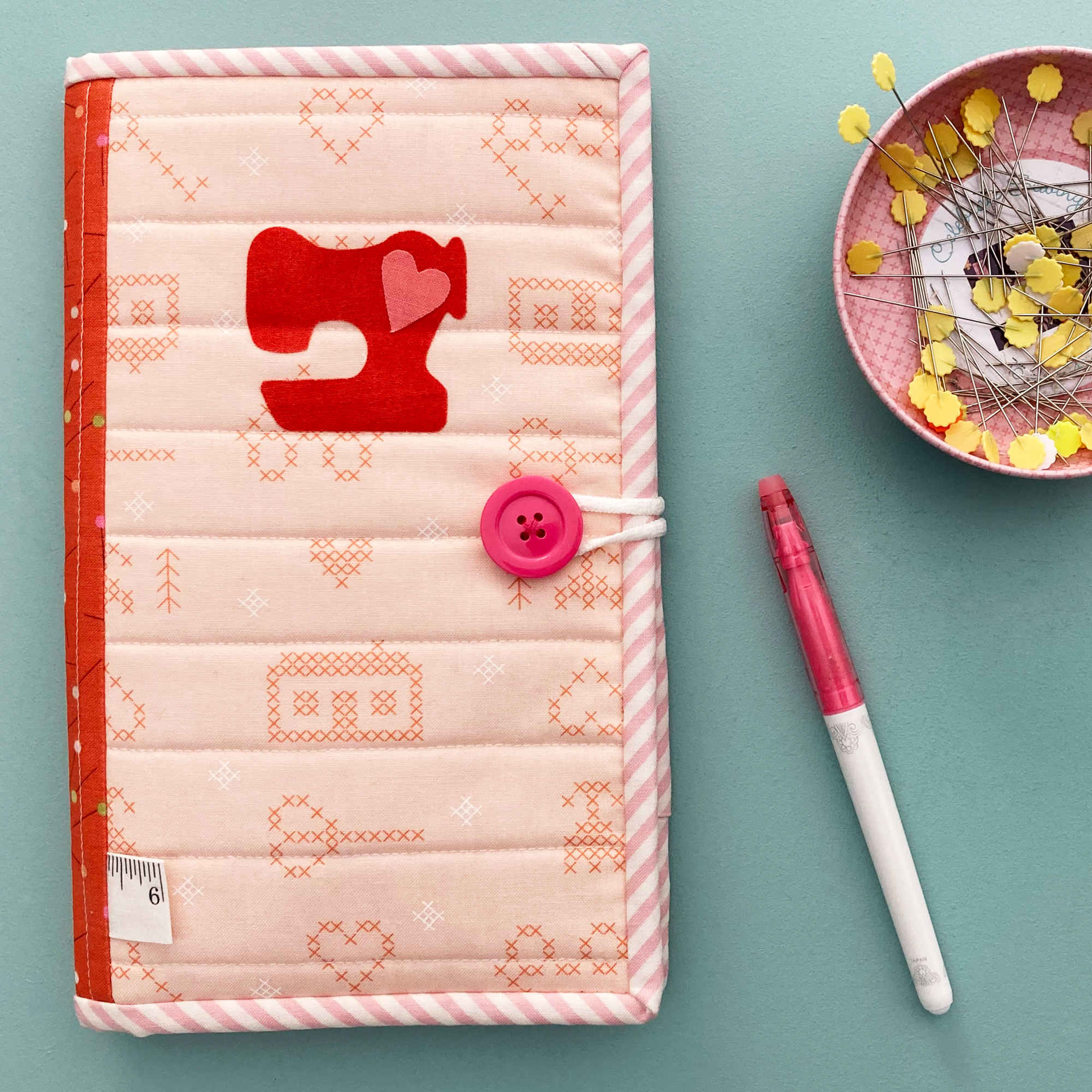Pink and orange small organizer with pins and marker