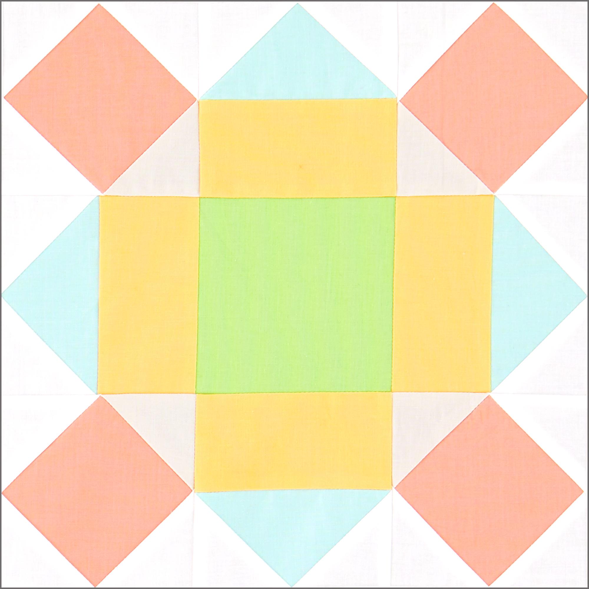 Block made of pink, aqua, yellow, and green squares