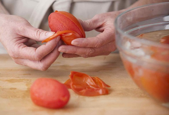 peel blanched and shocked tomatoes