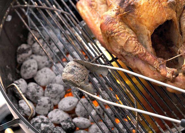 650 x 465 101618100 BBQ turkey on a grill photo by Meredith