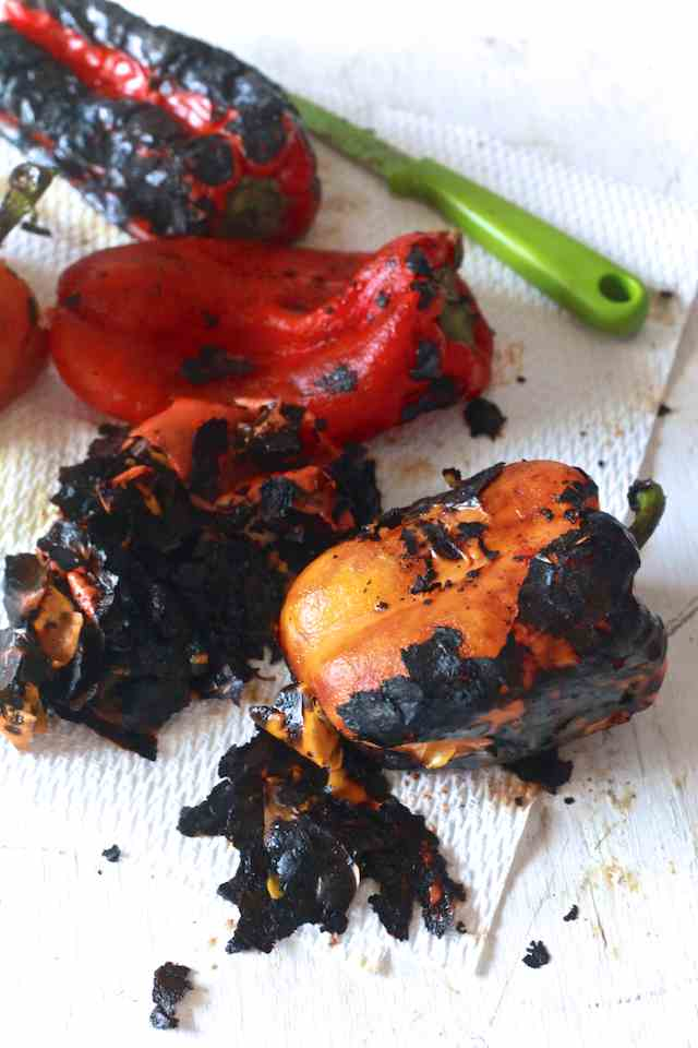 scraping skin off roasted peppers