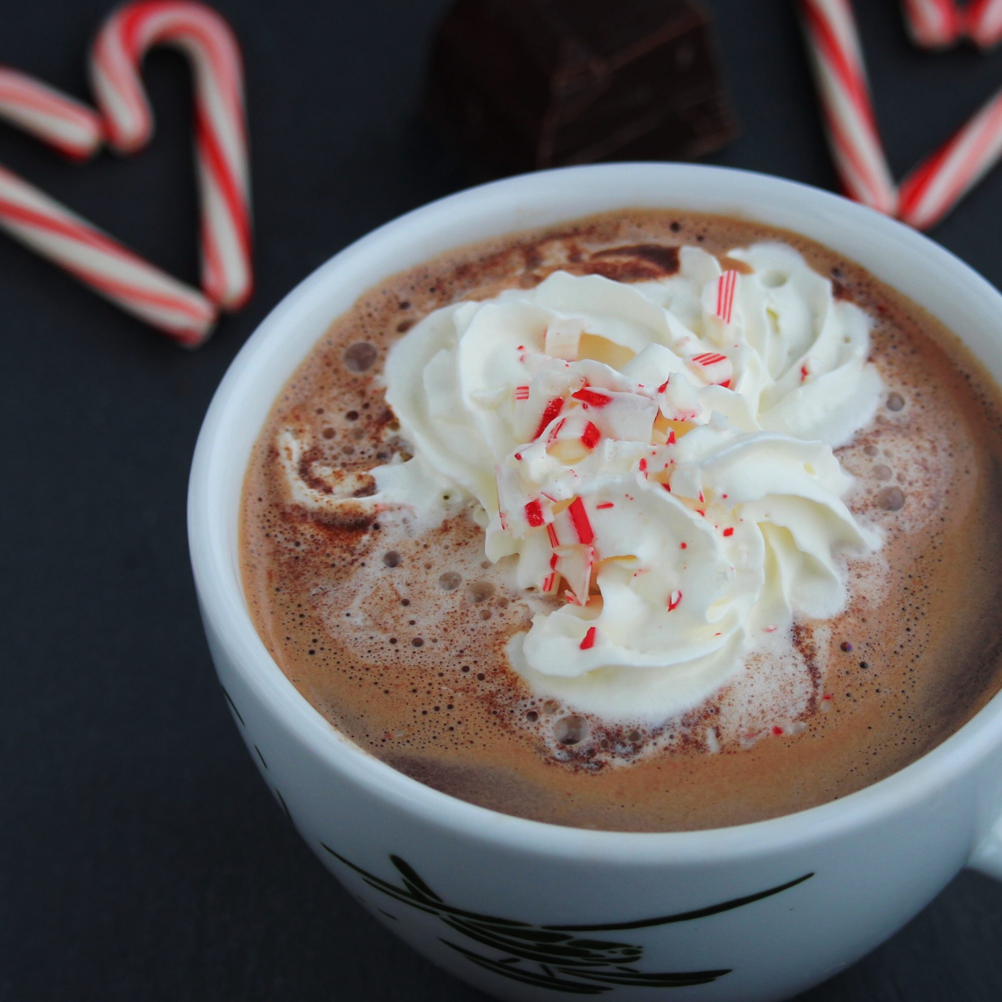 hot chocolate with candy canes and whipped cream