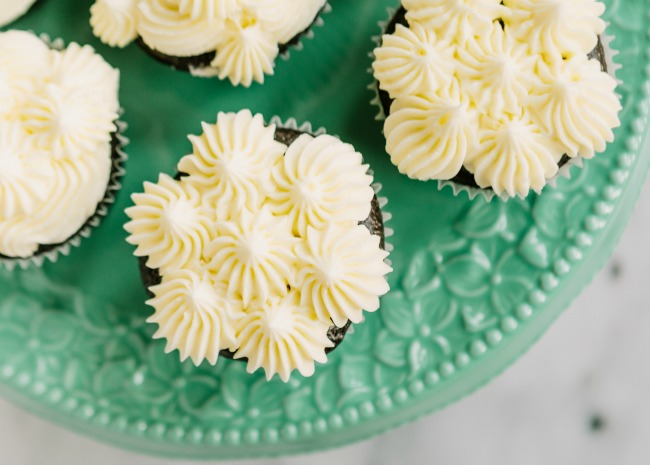 frosted cupcakes on a plate