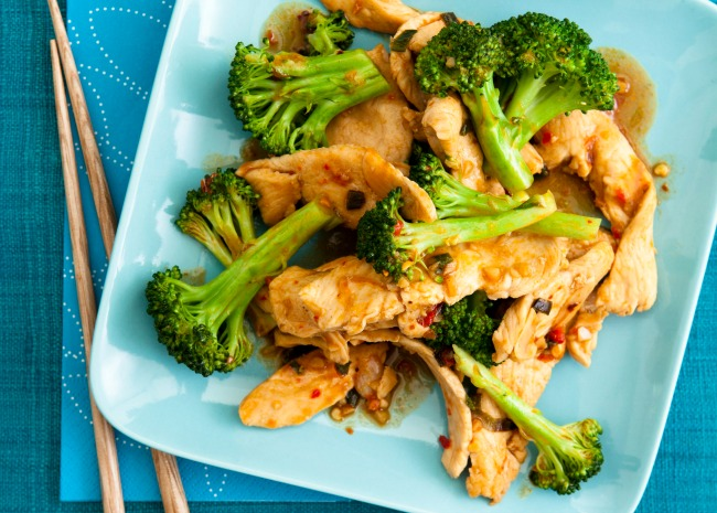 Stir Fried Chicken and Broccoli on a plate with chopstick on the side