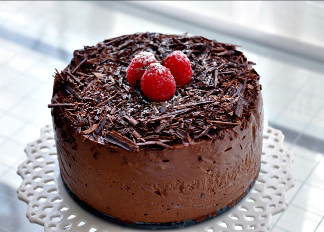 Chocolate Cappucccino Cheesecake topped with chocolate shavings and raspberries