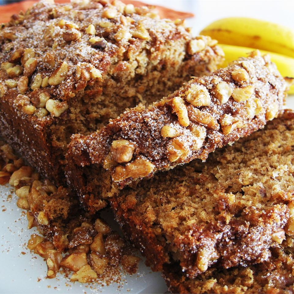 sliced maple banana bread with chopped nuts and sugar topping