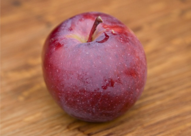 one empire apple on a wooden surface